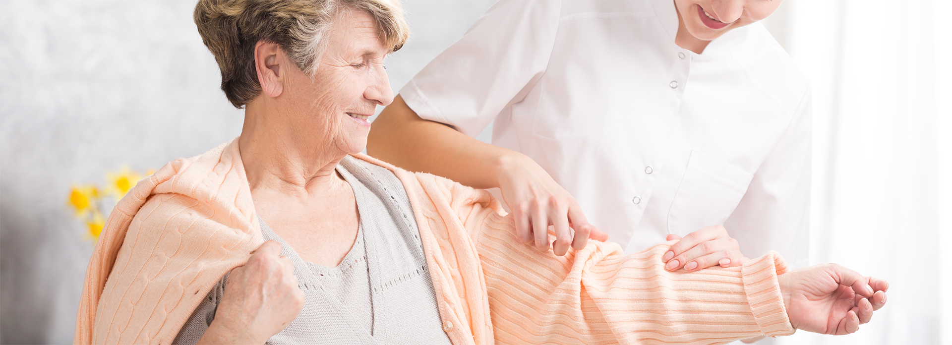 young-nurse-helping-elderly-woman-PAWNESZ